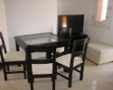dining-table-4-chairs-pouffee-tv-unit